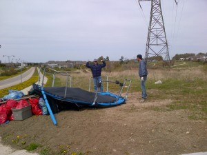Government Affairs director, Thomas Bryll, celebrates the disposal of a discarded trampoline.